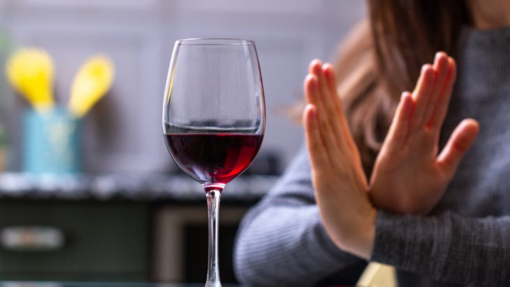 Woman saying no to alcohol after drug and alcohol addiction treatment