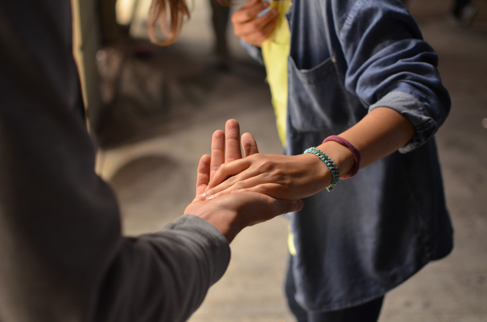 Close up of two hands providing support with continuing care toronto