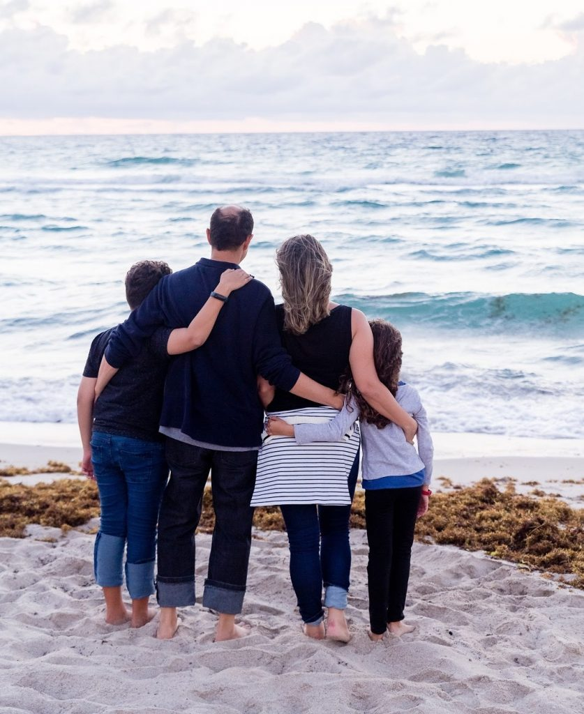 Family standing together healed after family program freedom from addiction
