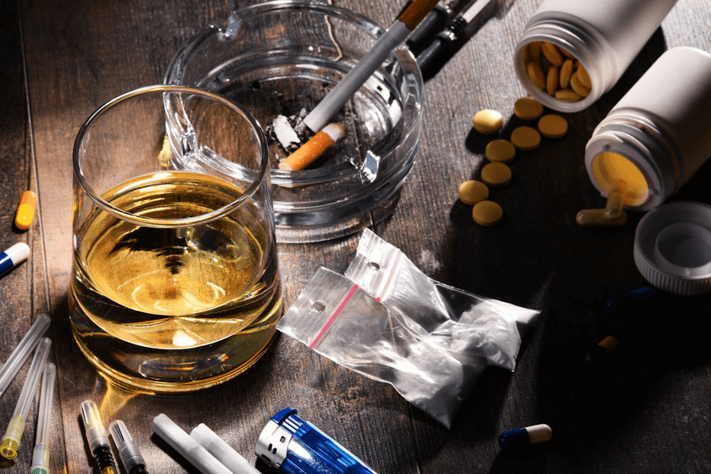 Drugs and alcohol spread across a table