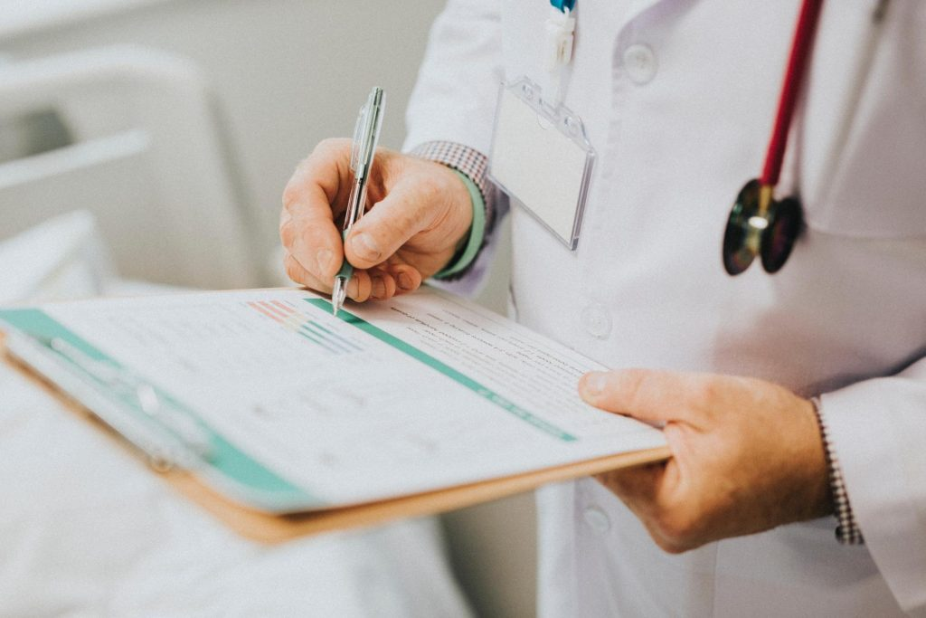 Close up of doctor writing an opioid prescription