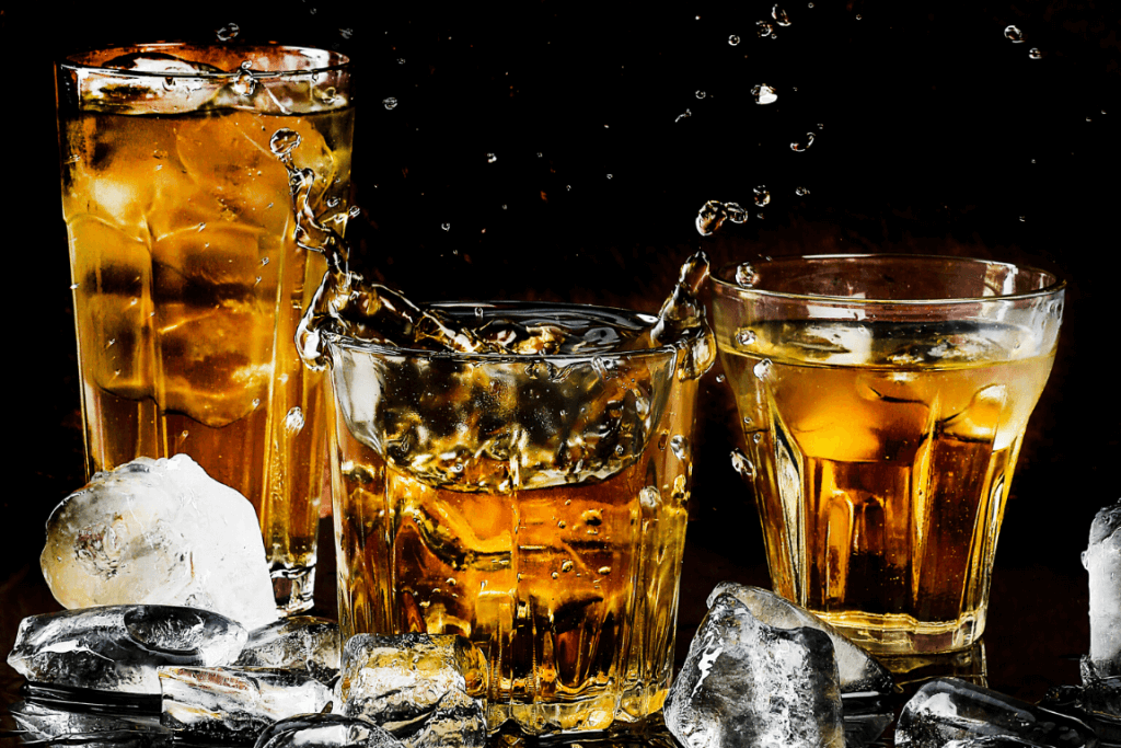 Close up of three glasses filled with alcohol