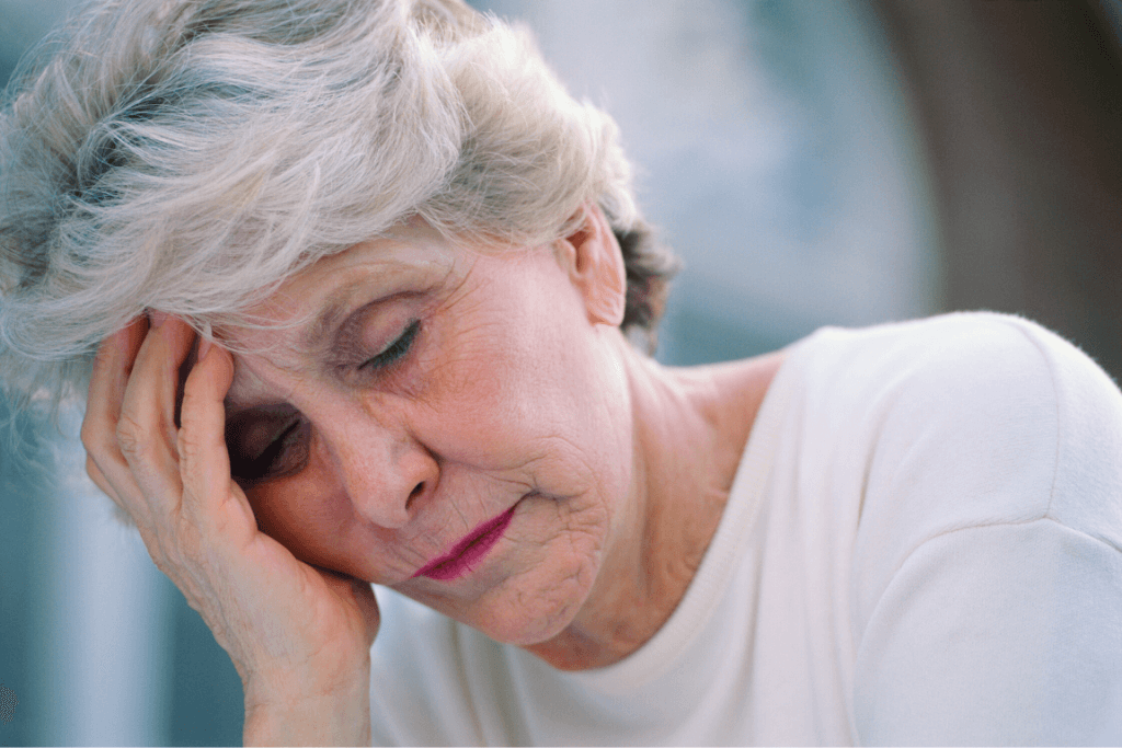 Close up of an older woman looking distressed