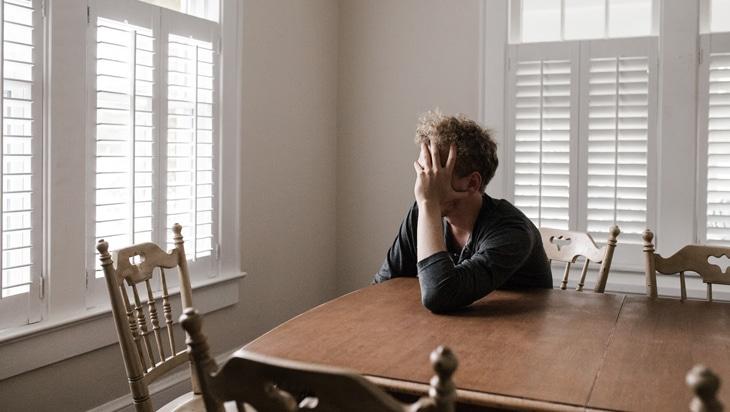 Male person alone at home