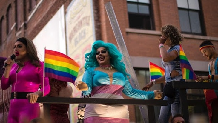 Queer people dressed in drag at a Pride parade