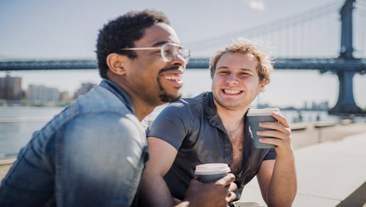 Two gay men drinking coffee