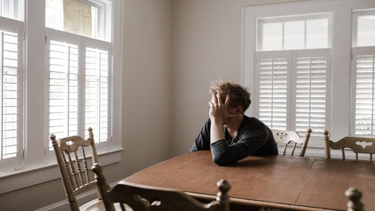 A depressed man in the dining area