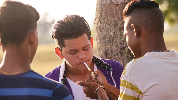 A group of young people smoking