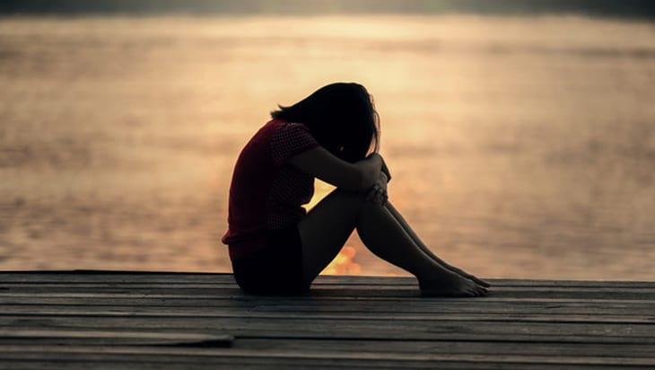 Sad woman by the sea