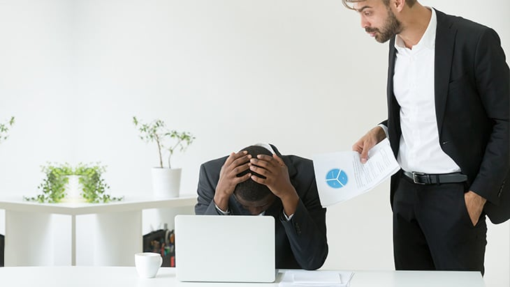 An employer upset with an employee at work