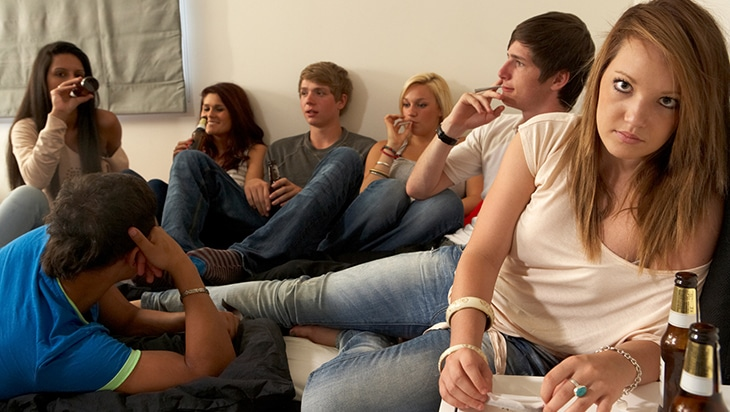 A group of teenagers drinking and smoking marijuana