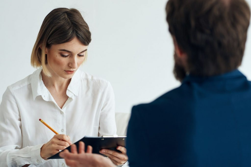 A consultation between a psychiatrist and a patient