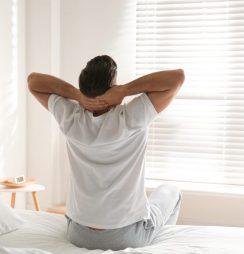 Man inside his bedroom in a drug rehab centre