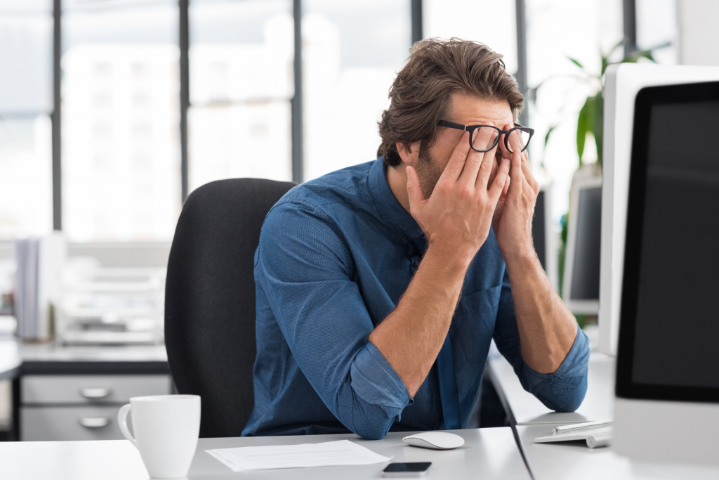A man stressed at work