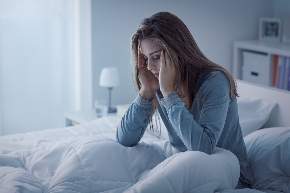 Woman who can't sleep due to anxiety.