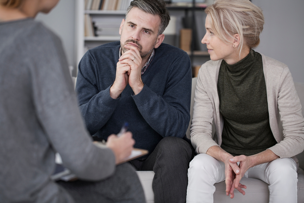 Man and woman taking partner therapy