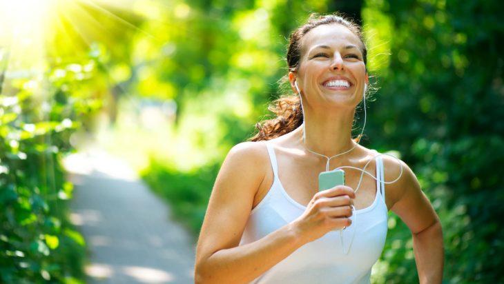 Happy, smiling woman jogging