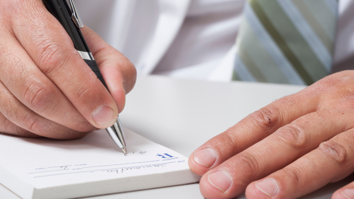 A doctor writing out a prescription