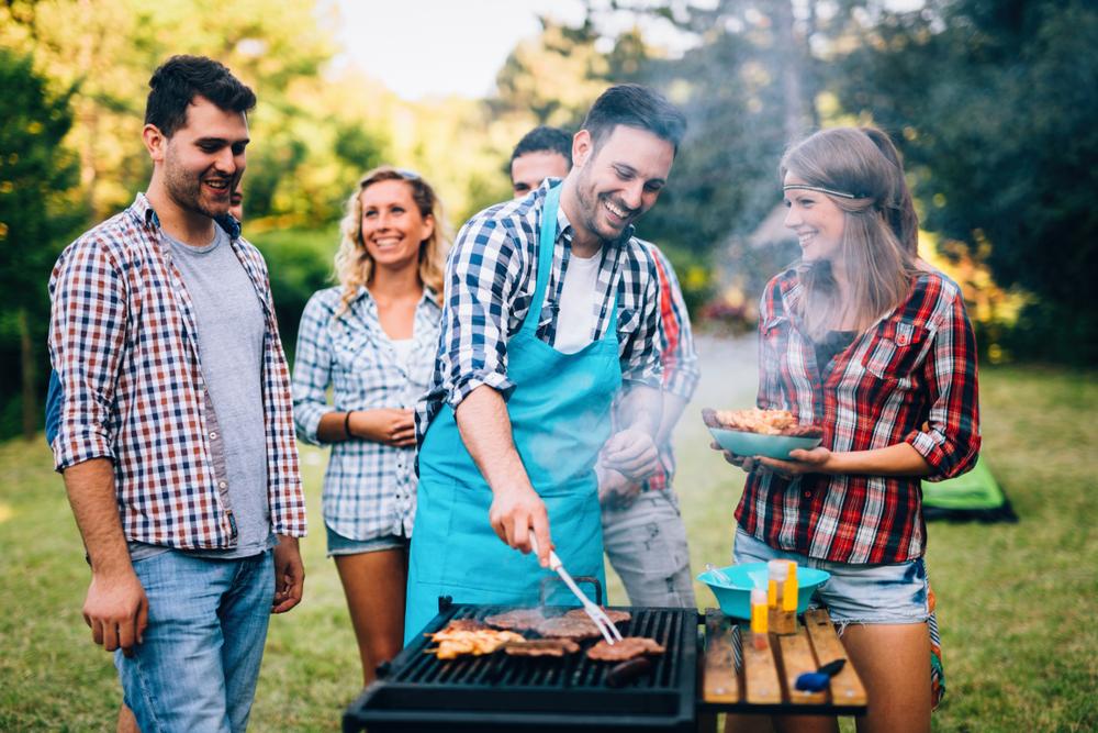 Happy friends having a sober barbeque party.